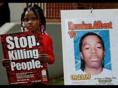 """This picture shows just how much this issue affects our children. in the picture she is holding a sign that reads """"stop killing people"""" next to a picture of someone that died do to gang violence that im assuming had some significance in that little girls life."""