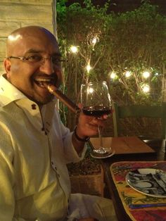 This guy is enjoying a fine #cigar over wine and dinner, and we're jealous!