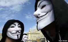 Anonymous masks. Snowden leaks: GCHQ 'attacked Anonymous' hackers