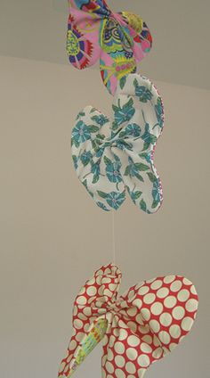 Butterfly mobile from fabric scraps - so easy you could change it for the seasons.  Maybe even try other shapes like ornaments for Christmas or hearts for Valentines