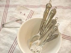 Measuring spoons in a white bowl Will be doing this