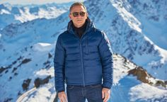 The blue jacket Daniel Craig wears on the photo call for the 24th Bond film Spectre at ski resort in Sölden (Austria) is a Canada Goose PBI Lodge Hoody.