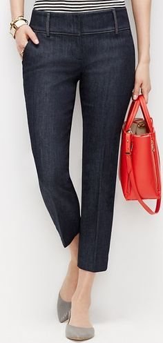 Denim jeans complimented by red purse always a winner.  Red accessors always add that special touch creating a stylish look!