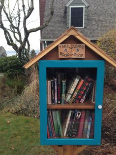 """Catherine Havener. Everett, WA.   We """"won"""" our little free library at the Everett High School Auction. The Bookworm Club and a very good cabinet maker partnered to create this beautiful library. It is full of personal touches, special bookmarks, magnets, and the coolest door knob ever!"""