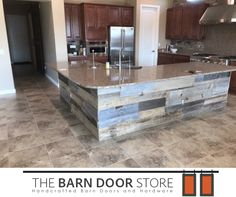 This reclaimed wood wrap looks amazing on this kitchen island in #CaveCreekAZ! #BarnDoorsAndMore #KitchenDecor #ReclaimedWood  TheBarnDoorStore.com