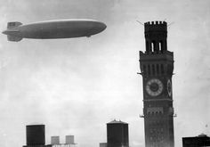 """The 804-foot-long dirigible Hindenburg, the """"Titanic of the Skies,"""" soars above the Bromo-Seltzer Tower on its way to Lakehurst (N.J.) Naval Air Station on August 11, 1936. Nine months later, it would explode at Lakehurst, killing 35 passengers and crew. (Baltimore Sun)"""