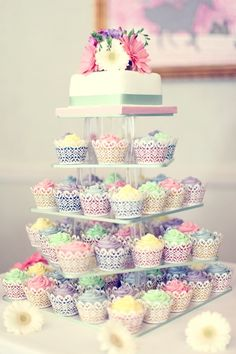 This colorful cupcake tower would be super cute at a bridal shower
