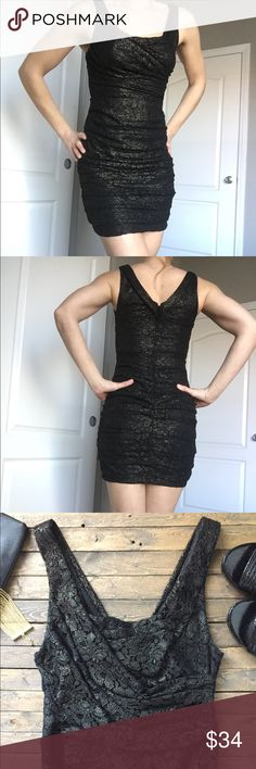 """Express form fitting dress Gorgeous form fitting ruched lace dress is black with gold accents. Just stunning! Fully lined with hidden zipper and closure at back. This dress is perfect for your holiday event. Worn once and in excellent condition. Chest measures at 13"""" and length is 34"""". Material is  polyester with some stretch. Home is smoke and pet free  Express Dresses Midi"""