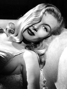 Veronica Lake's peek-a-boo hairstyle. What my grandpa calls my little girl because of her hair. Love it