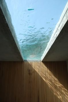 Love this water feature on the top level as a sky light for the lower levels