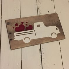 Valentine Truck sign made from reclaimed wood. Every sign is unique with possible imperfections because they are made from old wood. Each sign is made to order and may not be the exact one pictured. Each sign has been hand painted with care using specialty paints and acrylics. Each sign is distressed