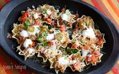 Skinny loaded nachos with turkey beans and cheese. This blog has TONS of good recipes!