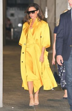 Victoria Beckham Photos Photos - Fashion designer Victoria Beckham is seen leaving an office building in New York City, New York on June 23, 2016. Victoria was wearing a bright yellow jacket to match her bright yellow dress. - Victoria Beckham Leaving An Office Building In New York