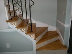 "The matching color swirl detail trim on the ""stringer board"" is total Julie, maybe with a flordelis design? Basement House, Basement Stairs, House Stairs, Baseboard Molding, Baseboards, Wood Staircase, Staircase Ideas, Hallway Ideas, Winder Stairs"