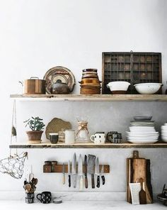 = soft grey walls, marble and open styled shelves