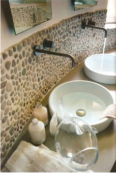 The art of nature can be utilized in so many ways...Love this bathroom for its style, cleanness and organic feel...