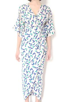 Description You can't go wrong with this stunning maxi dress that features hand-printed falling petals on a white background, adding visual texture and fun to your day. We love that the dress transiti