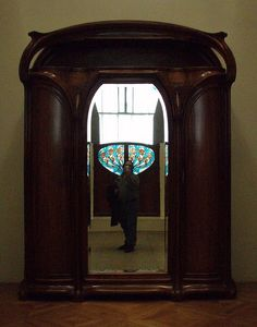art nouveau - I like the stained glass doors (or window shutters) behind the photographer in the mirror too!
