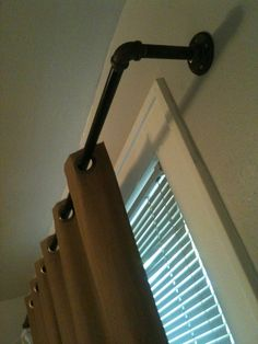 Industrial pipe curtain rods.  Need to make a trip to the hardware store.