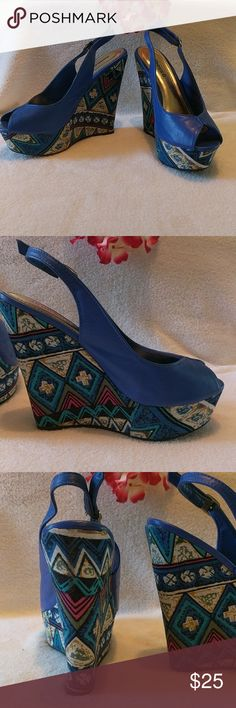 "Dollhouse size 7 wedges Eliza ,Geometrica Design . Dollhouse size 7 wedges , Eliza , beautiful blue with colorful geometric designs . Has a tiny worn spot on outer left shoe , and a very tiny spot on outer right shoe  not bad see last picture .5.5"" heel back , 1.5 "" high toe. adjustable ankle straps . gently used. Dollhouse Shoes Wedges"