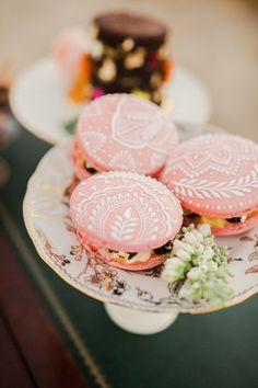Happening right around sunset, this intimate reception is full of dreamy details, including beautiful hand-painted macarons with a henna design.