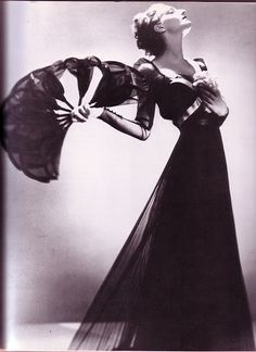 """""""I've had my best times when trailing a Mainbocher evening gown across a sawdust floor. I've always loved high style in low company."""" Anita Loos"""
