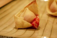 Raspberry Cheesecake Rangoons -- You can even make them with jelly instead of sauce if you're feeling extra lazy.