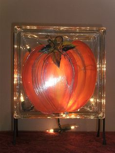 Lit pumpkin glass block
