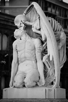 * The kiss of death ~ This astonishing sculpture forms part of Barcelona's Poblenou Cemetery. The Kiss of Death (El Petó de la Mort in Catalan and El beso de la muerte in Spanish) dates back to 1930. A winged skeleton bestows a kiss on the lips of a handsome young man: is it ecstasy on his face or resignation? Little wonder the sculpture elicits strong and varying responses from whoever gazes upon it.