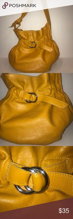 "Mustard Innue bag!!🔥 Mustard genuine leather bag by Innue!!🔥has buckle on the front and magnetic snap on the inside. Feels so supple!!! Stain on bottom of inside of the bag. Can see in photo. Width 13"" height 13"" depth 4 3/4"" and 28"" strap. One of the colors for Fall!!!! Innue Bags Shoulder Bags"
