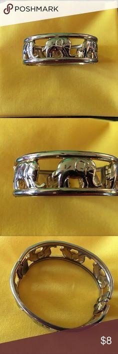 Selling this Silvertone Elephant Bangle on Poshmark! My username is: doraannv. #shopmycloset #poshmark #fashion #shopping #style #forsale #Jewelry