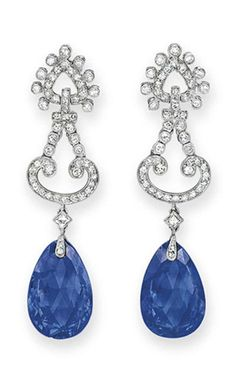 A PAIR OF SAPPHIRE AND DIAMOND EAR PENDANTS, BY CARTIER  Each suspending a drop-shaped faceted sapphire, to the single-cut diamond scrolling surmount, mounted in platinum Signed Cartier, no. 2317760