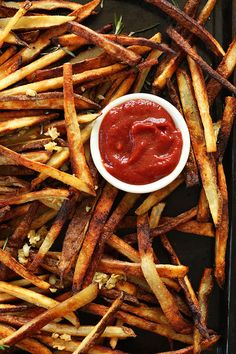 Slice Russet potatoes into matchsticks and bake golden garlic fries.