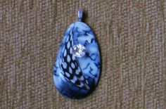 Winter solstice pendant with genuine white topaz and sterling silver chain by GodgivenTalent on Etsy