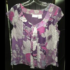 Worthington Silk Floral Top Worthington Silk Floral Top with bow at neckline > 100% Silk with Polyester lining.  Colors: Purple, Silver, Pink, White Worthington Tops