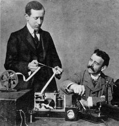 "Dot-Dot-Dot (Morse for the letter ""S"") was what the 27-yr-old Guglielmo Marconi and aide G.S. Kemp received on Dec 12, 1901. The moment was thought historic enough to restage for this photo because the two had been in Newfoundland - and the code sent from Cornwall, England, 1800 miles away. The Italian-Irish Marconi won the 1909 physics Nobel for his contributions to the infant medium of radio."