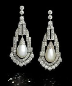 A pair of art deco natural pearl and diamond pendent earrings, circa 1925