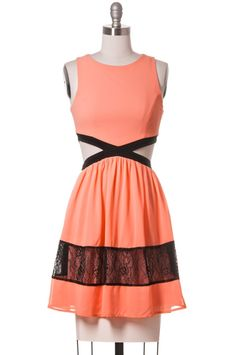 Featuring flirty cutouts and contrast lace fabric adorn this fully lined dress. The super trendy design is a favorite this season. With a sleeveless design and back zipper this is the perfect cute and flirty summer dress.