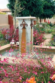 Rusted metal spouts mounted on all four sides of the central pillar spurt water into the raised basin below, creating that much-loved sound so suggestive of tranquillity. It's the perfect choice of water feature for a small to medium-sized garden. Photograph: Loren Shirley Carr