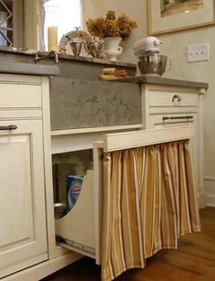 Sink base cabinet with pull-out drawer, and gathered fabric instead of false door panels