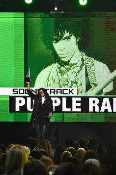 Prince's sister, Tyka Nelson accepts Purple Rain American Music Award on November 20, 2016 for Prince three decades later!!!