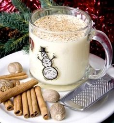 Low-fat Eggnog /  3/4 cup sugar 1/4 tsp cinnamon 1/4 tsp nutmeg 1 egg 4 egg whites 1 1/2 cups fat free milk 1 1/2 cups fat free half-and-half 1 1/2 tsp vanilla extract 1/4 cup rum or brandy (optional) freshly grated nutmeg to garnish