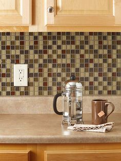 "Give your kitchen a new look in just one weekend with a do-it-yourself tile backsplash. It's easy with our free printable guide and simple-to-install mosaic tile sheets. ""How to Tile Your Backsplash"" by Better Homes and Gardens Deco Design, Küchen Design, Kitchen Redo, Kitchen Remodel, Room Kitchen, Kitchen Cabinets, Diy Tuiles, Eames Design, Diy Tile Backsplash"