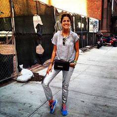 man repeller - neon sneakers - silver pants theyskens' theory- valentino purse