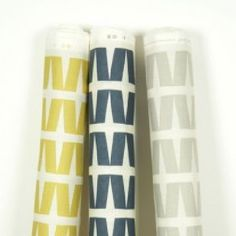 Natasha Marshall - Ikon Print Fabric Collection - 3 bolts of white fabric, all with a pattern of rows of slanting rectangles, 1 in light gold, 1 in navy, and 1 in pale grey Roman Blinds, White Fabrics, Ikon, Fabric Design, Printing On Fabric, Curtains, Pattern, Collection, Navy