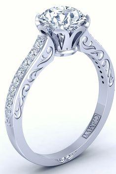 Vintage style flower inspired diamond engagement ring