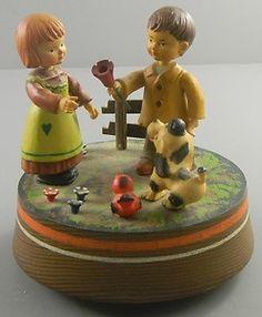 Anri Music Box Boy Girl Dog and a Bird  http://www.ebay.com/itm/Anri-Music-Box-Boy-Girl-Dog-and-Bird-/330718513404?pt=LH_DefaultDomain_0=item4d005c08fc#ht_3477wt_754