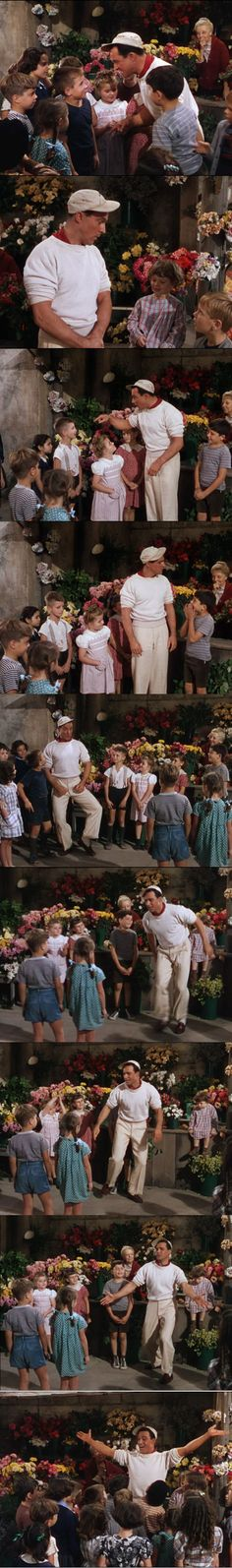 My favorite scene, save for the fantasy at the end, in this film: Gene Kelly tap-dancing and singing for the French kids in An American in Paris 1951. One of the reasons I consider this film just as good as Singin' in the Rain