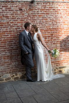 Must have wedding photo of the bride and groom against the brick wall of Fegley's Allentown Brew Works. J. Ciuppa Photography.