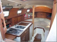 This is a glimpse at the inside of the cabin of a 1992 Flicka. Pacific Seacraft is known for their quality, evident here in the abundant use of genuine teak and mahogany woods. Boat Building Plans, Boat Plans, Building Ideas, Cuddy Cabin Boat, Sailboat Restoration, Camper Boat, Small Yachts, Sailboat Interior, Small Sailboats